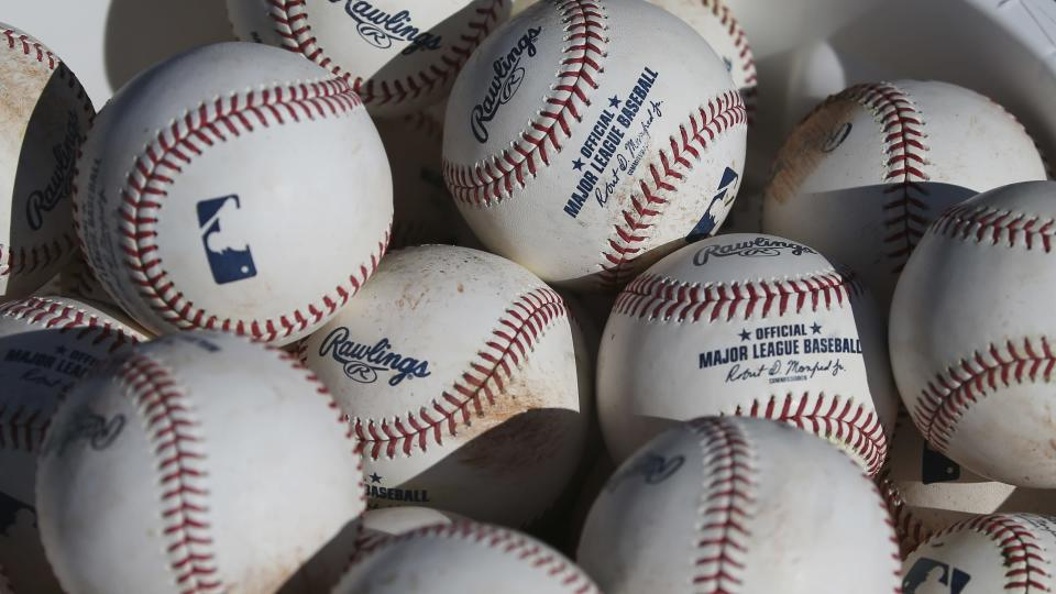 FILE - In this Feb. 14, 2020, file photo, baseballs sit in a bucket after they were used for fielding practice during spring training baseball workouts for pitchers and catchers at Cleveland Indians camp in Avondale, Ariz. Pitchers will be ejected and suspended for 10 games for using illegal foreign substances to doctor baseballs in a crackdown by Major League Baseball that will start June 21. The commissioner's office, responding to record strikeouts and a league batting average at a more than half-century low, said Tuesday, June 15, 2021 that major and minor league umpires will start regular checks of all pitchers, even if opposing managers don't request inspections. (AP Photo/Ross D. Franklin, File)