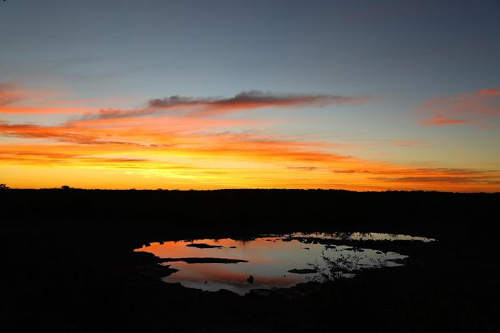 Another dramatic sunset at the Moringa waterhole, always worth the price of admission. Sunsets are quiet, with only the sounds of wildlife and cameras clicking. (Photo: Gordon Donovan/Yahoo News)