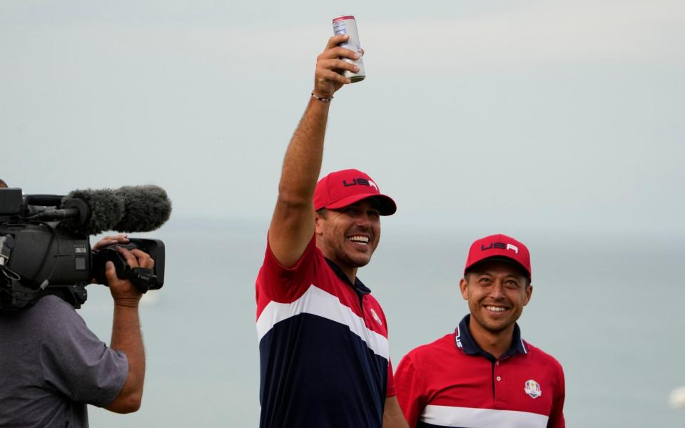 Team USA's Brooks Koepka holds up his drink after winning during a Ryder Cup singles match - AP