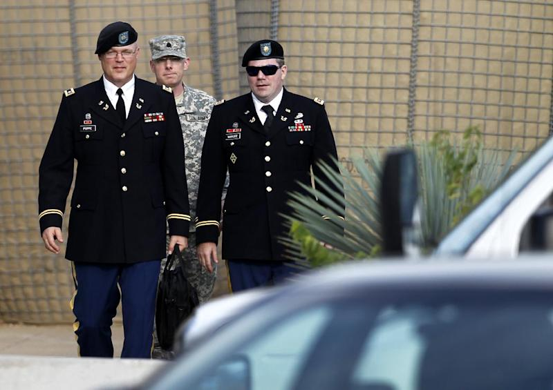 From left, members of the defense, U.S. Army Lt. Col. Kris R. Poppe, Maj. Christopher E. Martin and Maj. Joseph T. Marcee, depart the Lawrence H. Williams Judicial Center, Thursday, Aug. 22, 2013, in Fort Hood, Texas. Military jurors haven't reached a verdict against the soldier on trial for the 2009 shooting rampage at Fort Hood. (AP Photo/Tony Gutierrez)