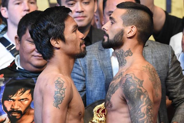 "Pacquiao is challenging ""The Machine"" Matthysse for the World Boxing Association welterweight belt on Sunday (AFP Photo/Mohd RASFAN)"