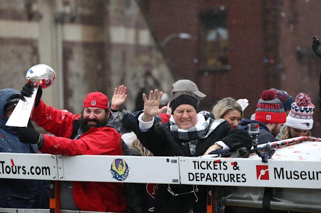 <p>Matt Patricia, left, holds up a Lombardi Trophy and New England Patriots head coach Bill Belichick waves during the New England Patriots Super Bowl LI Victory Parade in Boston on Feb. 7, 2017. (Photo by David L. Ryan/The Boston Globe via Getty Images) </p>