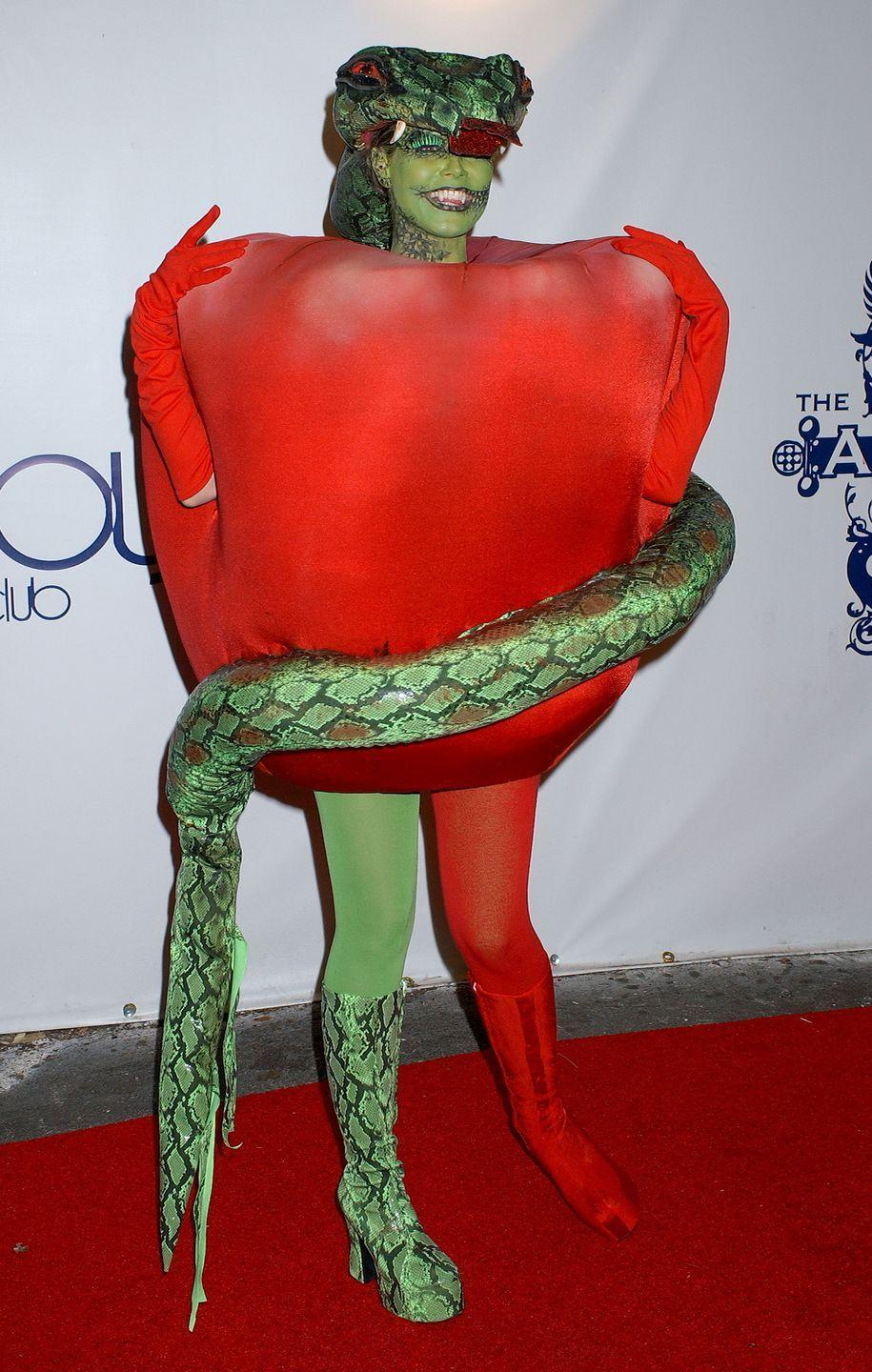 <p>Heidi concealed her pregnancy in 2006 by wearing giant apple costume with a snake wrapped around it. </p><p>We wonder what else she hid in there. </p>