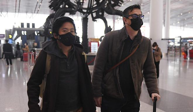 Wall Street Journal reporters Philip Wen (left) and Josh Chin walk through Beijing Capital Airport after being expelled from China on February 24. Photo: AFP