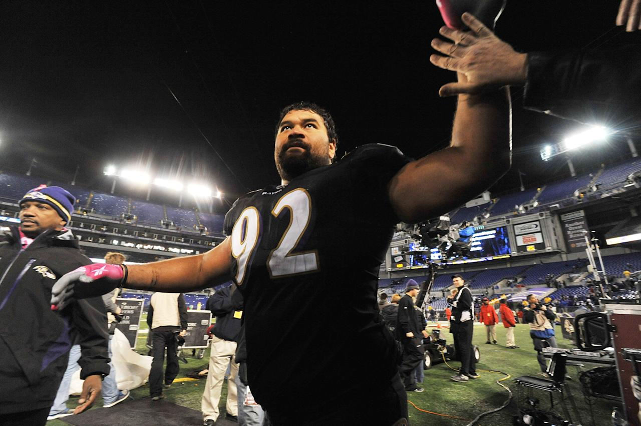 BALTIMORE - OCTOBER 2:  Haloti Ngata #92 of the Baltimore Ravens waves to the crowd after the game against the New York Jets at M&T Bank Stadium on October 2. 2011 in Baltimore, Maryland. The Ravens defeated the Jets 34-17. (Photo by Larry French/Getty Images)