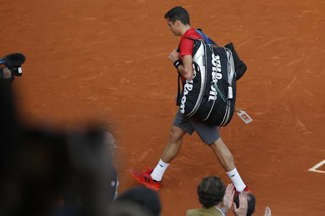 Canada's Milos Raonic leaves after losing the quarterfinal match of the French Open tennis tournament against Serbia's Novak Djokovic at the Roland Garros stadium, in Paris, France, Tuesday, June 3, 2014. Djokovic won in three sets 7-5, 7-6, 6-4. (AP Photo/Michel Euler)