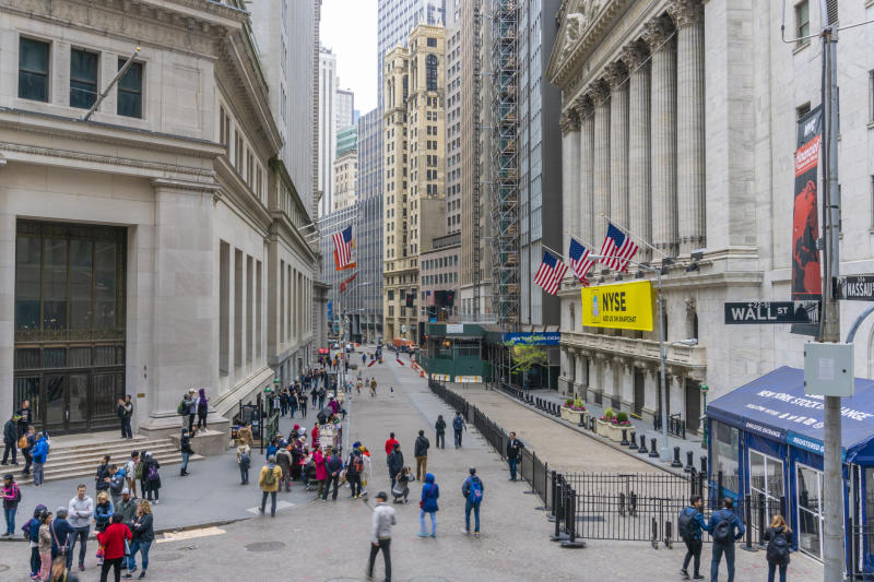 Wall Street and the front of the New York Stock Exchange.