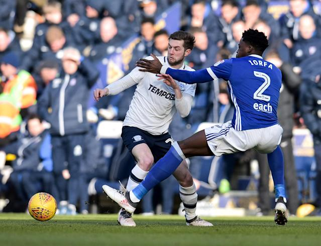 """Soccer Football - Championship - Preston North End vs Ipswich Town - Deepdale, Preston, Britain - February 24, 2018 PrestonÕs Tom Barkhuizen in action with Ipswich Town's Dominic Iorfa Action Images/Paul Burrows EDITORIAL USE ONLY. No use with unauthorized audio, video, data, fixture lists, club/league logos or """"live"""" services. Online in-match use limited to 75 images, no video emulation. No use in betting, games or single club/league/player publications. Please contact your account representative for further details."""
