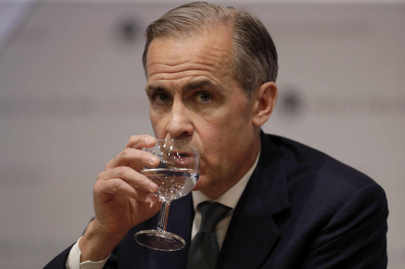 Mark Carney the Governor of the Bank of England sips water during an Inflation Report Press Conference at the Bank of England in the City of London, Thursday, May 2, 2019. (AP Photo/Matt Dunham, Pool)