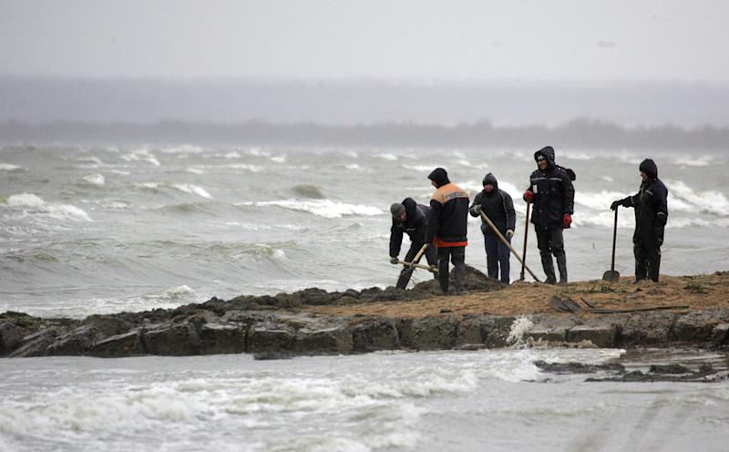 Russian Emergency Ministry personnel clean a section of the Black Sea shore in Tuzla Spit November 13, 2007