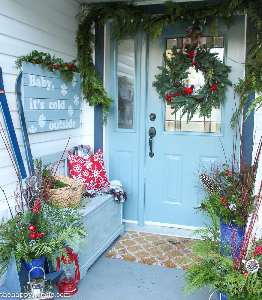 """<p>Blue isn't just for summertime, beachy decor: Add the hue to the wintry mix for a pretty visual aesthetic that pops against traditional red and green holiday decorations.<br></p><p><strong><em>Get the look at <a href=""""https://thehappyhousie.porch.com/classic-christmas-porch-entry-hall-tour/"""" rel=""""nofollow noopener"""" target=""""_blank"""" data-ylk=""""slk:The Happy Housie"""" class=""""link rapid-noclick-resp"""">The Happy Housie</a>.</em></strong></p>"""