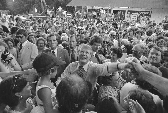 Then-Democratic presidential nominee Jimmy Carter presses the flesh on arrival in Plains, in July 1976. (Photo: Peter Bregg/AP)