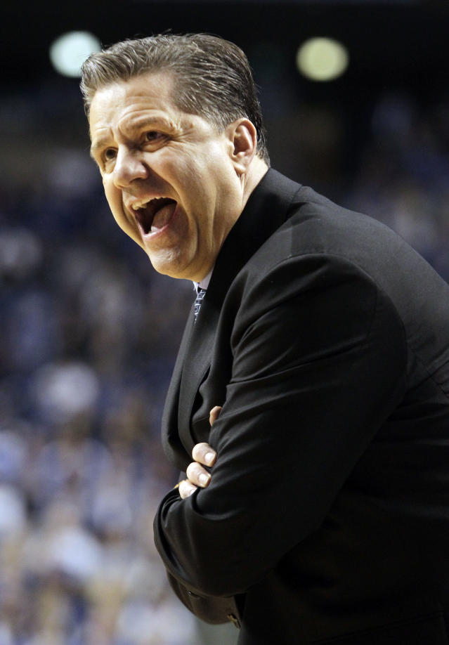 Kentucky head coach John Calipari shouts to his team during the second half of an NCAA college basketball game against Mississippi, Tuesday, Feb. 4, 2014, in Lexington, Ky. Kentucky won 80-64. (AP Photo/James Crisp)