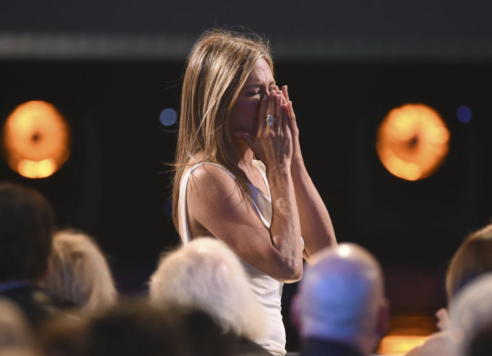 """Jennifer Aniston reacts before going on stage to accept the award for outstanding performance by a female actor in a drama series for """"The Morning Show"""" at the 26th annual Screen Actors Guild Awards at the Shrine Auditorium & Expo Hall on Sunday, Jan. 19, 2020, in Los Angeles. (Photo/Chris Pizzello)"""