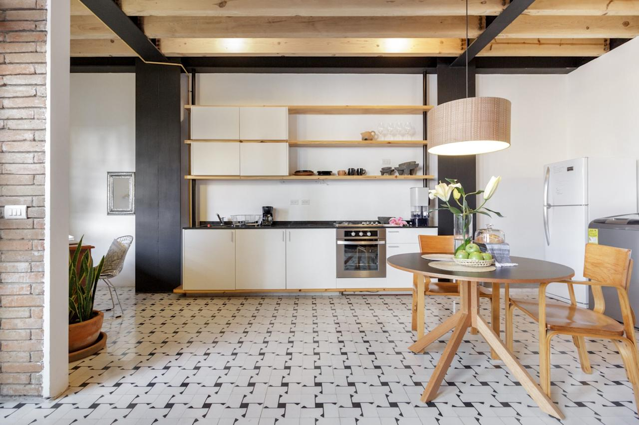 """<p>With an open kitchen, dining area, small living room, and tucked away queen-sized bed, this apartment has everything a solo traveler could need—and is in Colonia Juárez, <a href=""""https://www.cntraveler.com/gallery/mexico-city-airbnbs-that-could-have-been-in-roma?mbid=synd_yahoo_rss"""" target=""""_blank"""">Roma's</a> hip and young neighbor. Use the savings from the hundred dollar studio for some of the handmade pastas at nearby <a href=""""https://www.cntraveler.com/restaurants/mexico-city-df/sartoria?mbid=synd_yahoo_rss"""" target=""""_blank"""">Sartoria.</a> Traveling for business? There's a designated desk area and, as an Airbnb Plus, the home's Wi-Fi has been tested for speed. The other perk to booking a night here? Host María has flowers and fresh bread waiting for you upon check-in.</p> <p><strong>Book now:</strong> <a href=""""https://airbnb.pvxt.net/Z1axK"""" rel=""""nofollow"""" target=""""_blank"""">Starting at $108 per night, airbnb.com</a></p>"""