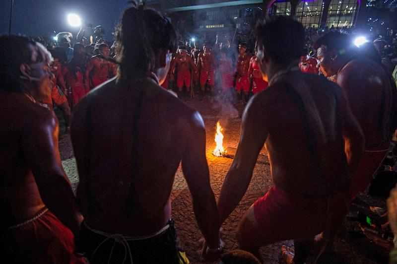 Indigenous people dance around a bonfire on the eve of the first World Indigenous Games in Palmas, Brazil on October 22, 2015 (AFP Photo/Christophe Simon)