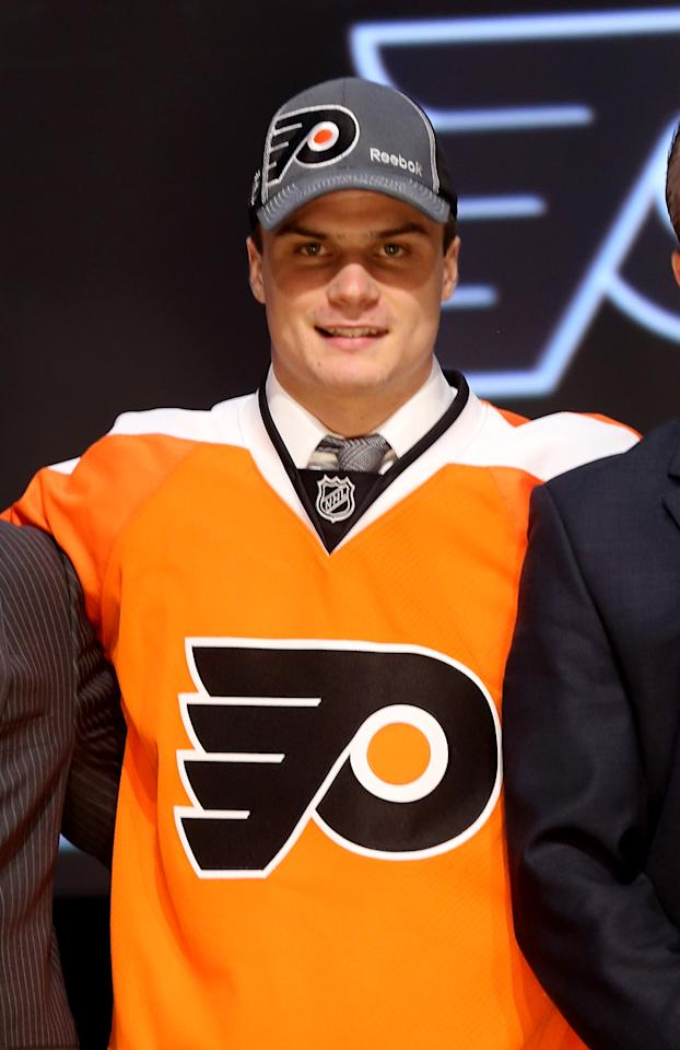 PITTSBURGH, PA - JUNE 22: Scott Laughton, 20th pick overall by the Philadelphia Flyers, poses on stage during Round One of the 2012 NHL Entry Draft at Consol Energy Center on June 22, 2012 in Pittsburgh, Pennsylvania.  (Photo by Bruce Bennett/Getty Images)