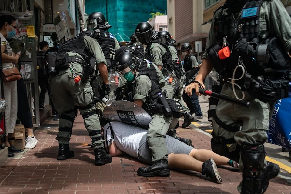 A man is detained by riot police during a demonstration in Hong KongGetty Images