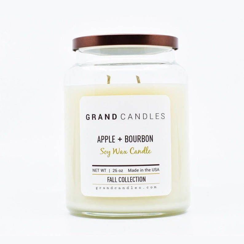 """<p><strong>GrandCandlesCo</strong></p><p>etsy.com</p><p><strong>$28.99</strong></p><p><a href=""""https://go.redirectingat.com?id=74968X1596630&url=https%3A%2F%2Fwww.etsy.com%2Flisting%2F659666204%2Fscented-candle-soy-candle-caramel-apple&sref=https%3A%2F%2Fwww.countryliving.com%2Fdiy-crafts%2Fg2655%2Fseasonal-candles%2F"""" rel=""""nofollow noopener"""" target=""""_blank"""" data-ylk=""""slk:Shop Now"""" class=""""link rapid-noclick-resp"""">Shop Now</a></p><p>This sweet-scented candle is hand-poured in small batches.</p>"""