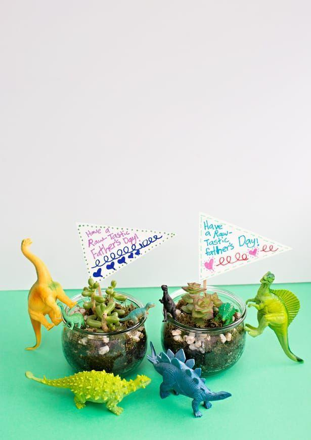 """<p>Both Dad and the kids will adore making these a-<em>roar-</em>able terrariums! Include small Father's Day flags to make them even better. </p><p><strong>Get the tutorial at <a href=""""https://www.hellowonderful.co/post/diy-dinosaur-terrariums-raw-tastic-father-s-day-gift-kids-can-make/"""" rel=""""nofollow noopener"""" target=""""_blank"""" data-ylk=""""slk:Hello Wonderful"""" class=""""link rapid-noclick-resp"""">Hello Wonderful</a>.</strong></p><p><a class=""""link rapid-noclick-resp"""" href=""""https://go.redirectingat.com?id=74968X1596630&url=https%3A%2F%2Fwww.walmart.com%2Fip%2FAdventure-Force-40-Piece-Jumbo-Bucket-Play-Set-Dinosaurs%2F107611325&sref=https%3A%2F%2Fwww.thepioneerwoman.com%2Fholidays-celebrations%2Fg36333267%2Ffathers-day-activities%2F"""" rel=""""nofollow noopener"""" target=""""_blank"""" data-ylk=""""slk:SHOP TOY DINOSAURS"""">SHOP TOY DINOSAURS</a></p>"""