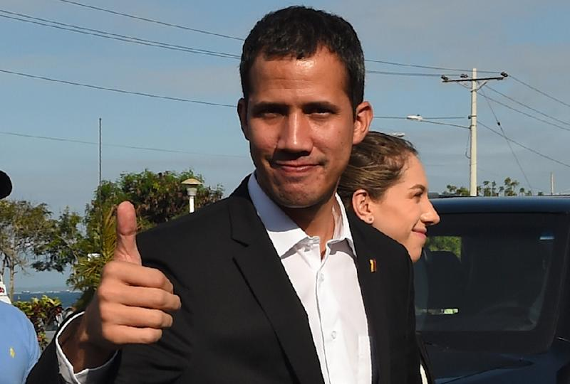 Venezuelan opposition leader and self-proclaimed acting president Juan Guaido says he is returning to his country on Monday (AFP Photo/Rodrigo BUENDIA)
