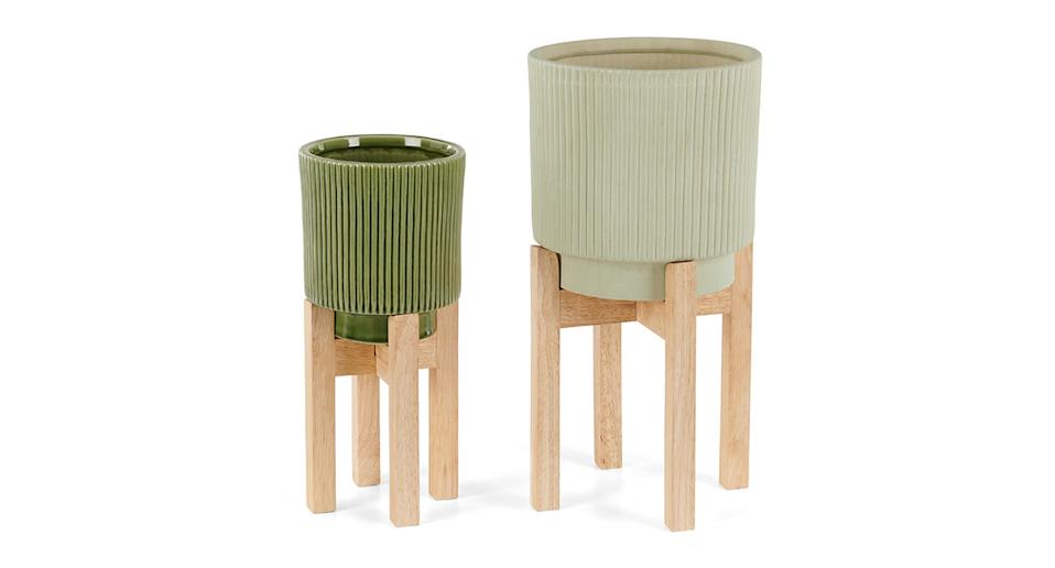 """MADE.COM doesn't just sell furniture. It does some great home accessories like these stylish plant pots on stands. Trust us, your mum will find a use for them. <a href=""""https://fave.co/2N4HTtP"""" rel=""""nofollow noopener"""" target=""""_blank"""" data-ylk=""""slk:Shop now."""" class=""""link rapid-noclick-resp""""><strong>Shop now.</strong></a>"""