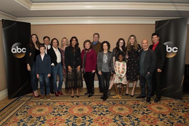 Channing Dungey and Roseanne Barr with cast and executive producers of <em>Roseanne</em> in January. (Photo: Group LA via Getty Images)
