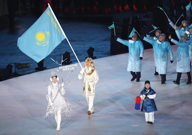 <p>Flag bearer Abzal Azhgaliyev of Kazakhstan leads the team during the Opening Ceremony of the PyeongChang 2018 Winter Olympic Games at PyeongChang Olympic Stadium on February 9, 2018 in Pyeongchang-gun, South Korea. (Photo by Ronald Martinez/Getty Images) </p>