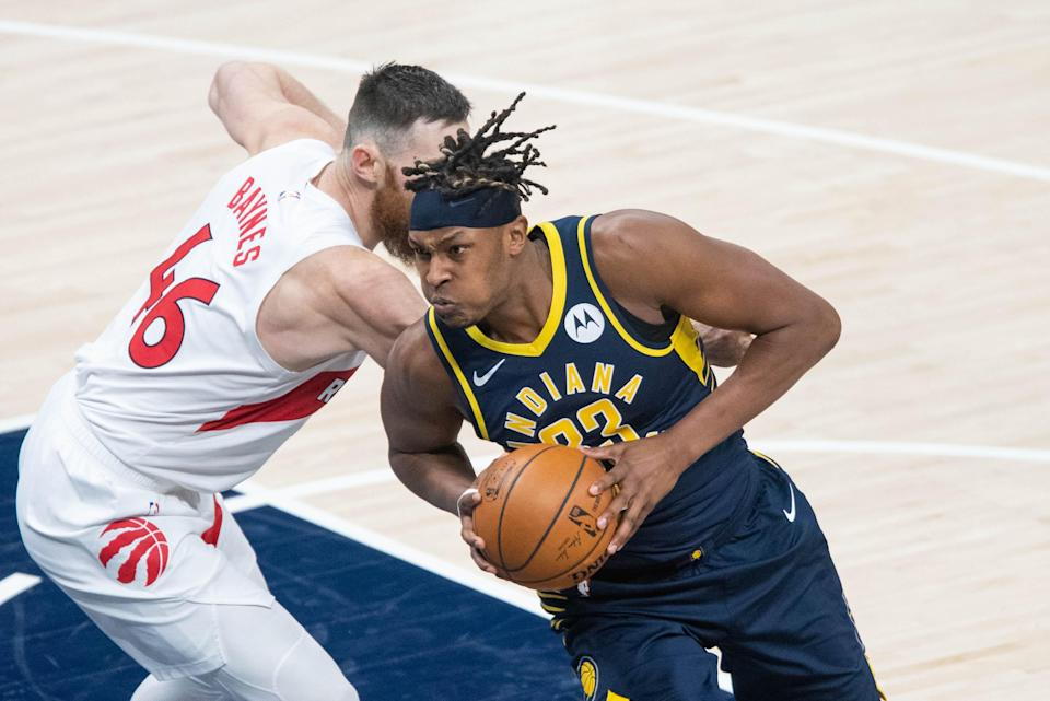 Jan 25, 2021; Indianapolis, Indiana, USA; Indiana Pacers center Myles Turner (33) moves to shoot the ball while Toronto Raptors center Aron Baynes (46) defends in the second quarter at Bankers Life Fieldhouse.