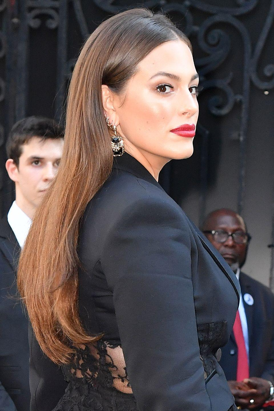 <p>Add more movement to your hair by bending the lengths over a straightening iron. It works even if you then tuck your hair behind your ears, as Ashley Graham shows.</p>