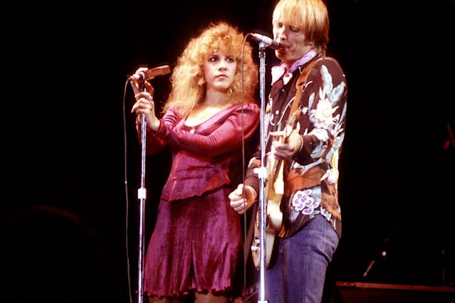 <p>Stevie Nicks and Tom Petty perform in 1981. (Photo: Larry Hulst/Getty Images) </p>