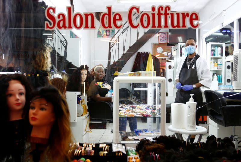 Hairdresser Nicky Chou poses in her hair salon at the Matonge gallery in Brussels