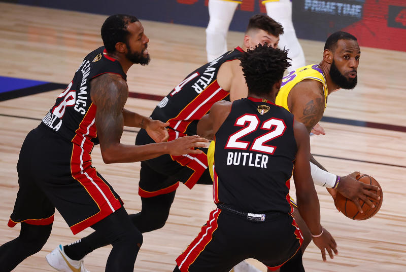 LAKE BUENA VISTA, FLORIDA - SEPTEMBER 30: Andre Iguodala #28 of the Miami Heat, Tyler Herro #14 of the Miami Heat and Jimmy Butler #22 of the Miami Heat defend LeBron James #23 of the Los Angeles Lakers during the second quarter in Game One of the 2020 NBA Finals at AdventHealth Arena at the ESPN Wide World Of Sports Complex on September 30, 2020 in Lake Buena Vista, Florida. NOTE TO USER: User expressly acknowledges and agrees that, by downloading and or using this photograph, User is consenting to the terms and conditions of the Getty Images License Agreement. (Photo by Kevin C. Cox/Getty Images)