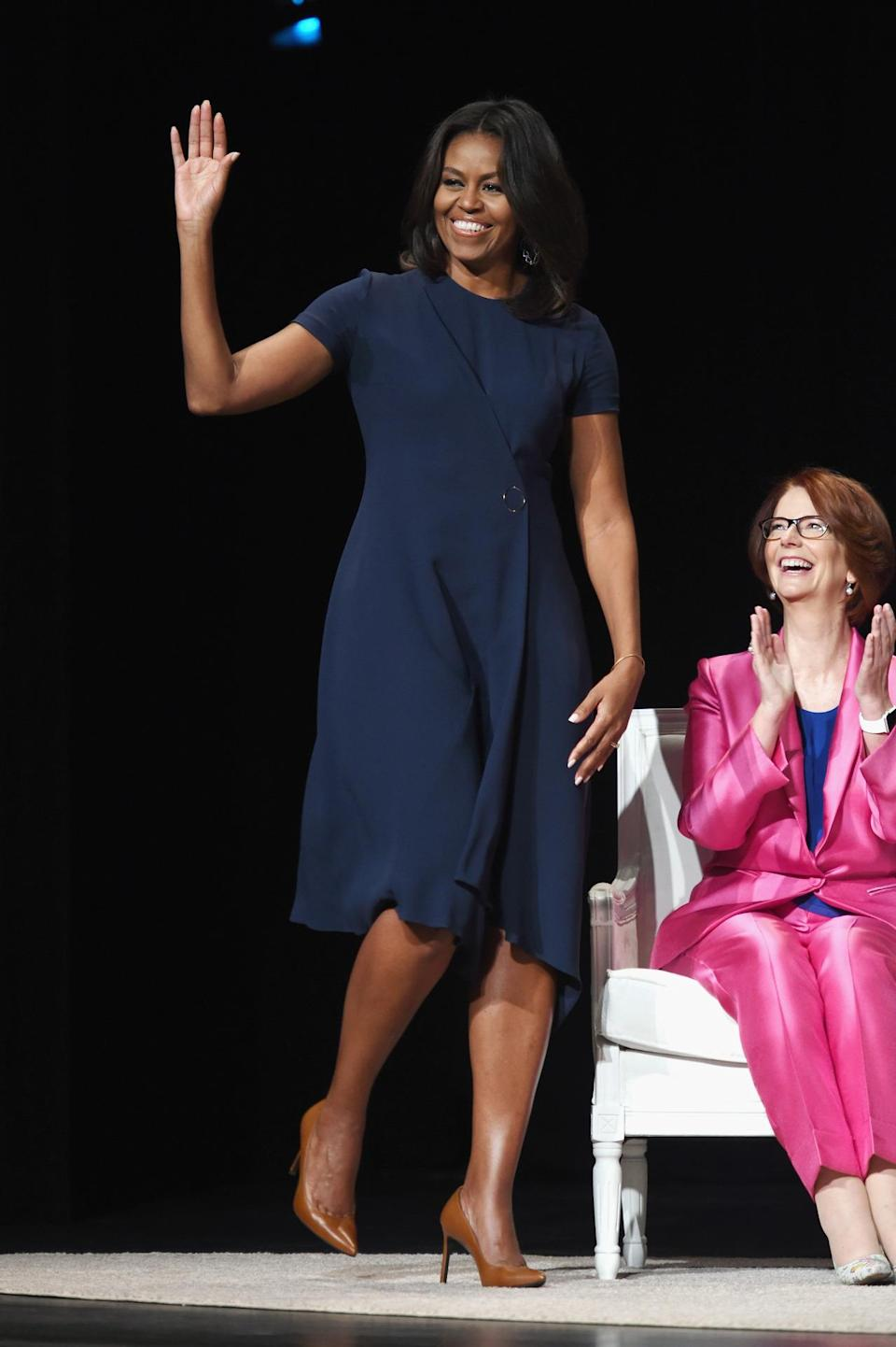 <p>For a daytime talk, Obama was all business wearing a navy blue wrap dress with cognac heels. </p>