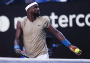 United States' Frances Tiafoe reacts as he argues with the chair umpire over a time violation while serving to Serbia's Novak Djokovic during their second round match at the Australian Open tennis championship in Melbourne, Australia, Wednesday, Feb. 10, 2021. Eliminating all line judges and removing the human element from officiating at the Australian Open might have been a necessary step to reduce the number of people on court amid a pandemic. It also might be good for the integrity of the game, because getting every call right matters so much to players and fans. (AP Photo/Rick Rycroft)
