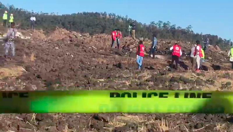 In this image taken from video, rescuers search through wreckage at the scene of an Ethiopian Airlines flight that crashed shortly after takeoff at Hejere near Bishoftu, or Debre Zeit, some 50 kilometers (31 miles) south of Addis Ababa, in Ethiopia, March 10, 2019. (Photo: Yidnek Kirubel/AP)