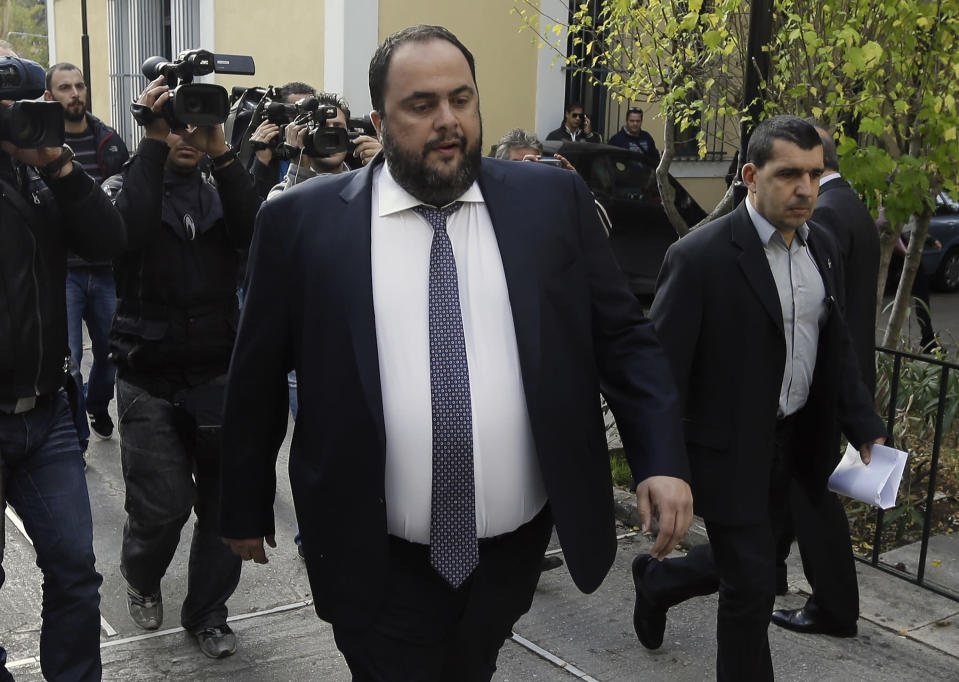 FILE - In this Nov. 19, 2014 file photo, Olympiakos soccer club chairman and Greece's most powerful businessmen Evangelos Marinakis arrives at court in Athens, Greece. As a result of U.S. sanctions on Venezuela, a high-stakes legal fight in U.S. federal court is pitting Marinakis against Venezuelan shipping magnate Wilmer Ruperti, in connection with oil tanker Alkimos carrying high octane gasoline estimated to be worth millions. (AP Photo/Thanassis Stavrakis, File)