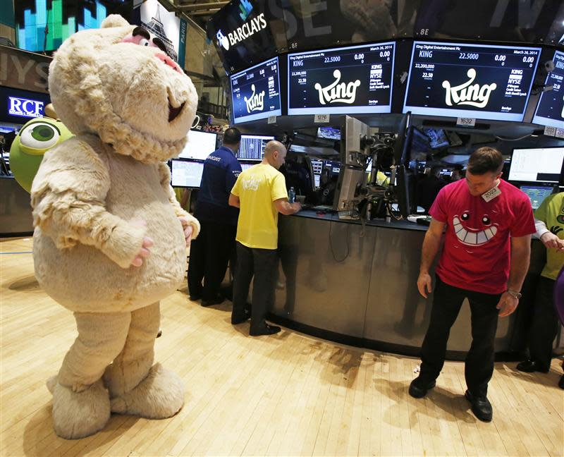 "A mascot dressed as a character from the mobile game ""Candy Crush Saga"" walks the floor of the New York Stock Exchange during the IPO of Mobile game maker King Digital Entertainment Plc"