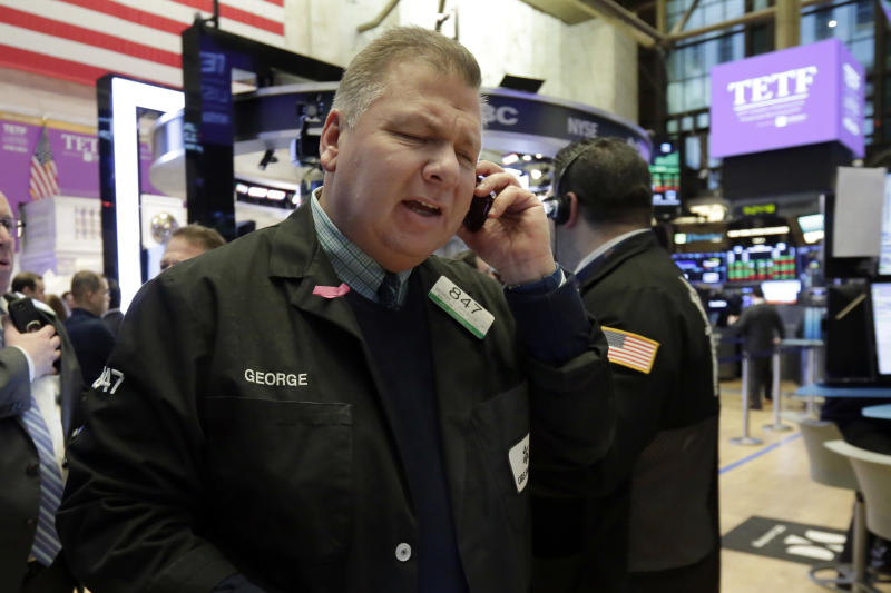 Trader George Ettinger works on the floor of the New York Stock Exchange, Friday, Feb. 23, 2018. Stocks are opening higher on Wall Street, led by gains in technology companies and banks. (AP Photo/Richard Drew)