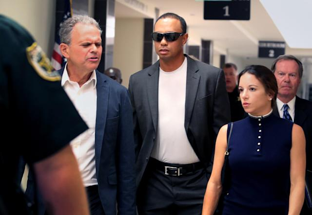 Tiger Woods left Palm Beach County (Fla.) court after resolving his May DUI charge. (AP)
