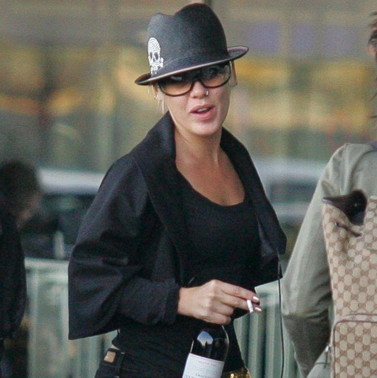 <p>Pink, traveling in style with a bottle of wine and a smoke, arrives at the Orly airport in September 2006 in Orly, France. </p>