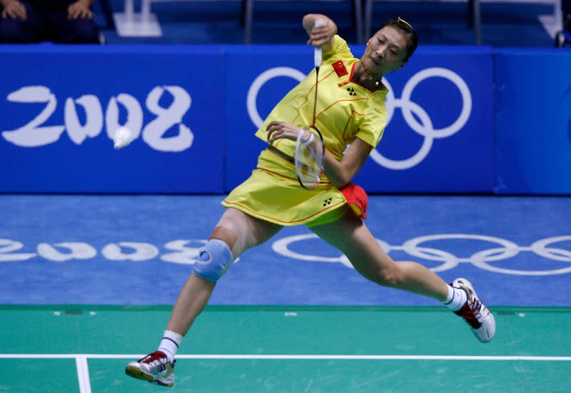 Zhang Ning of China returns the ball to her compatriot Xie Xingfang during their women's singles final badminton match againstat the Beijing 2008 Olympic Games