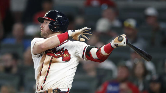 Atlanta Braves' Josh Donaldson ollows through on a solo home run in the sixth inning of a baseball game against the Los Angeles Dodgers, Saturday, Aug. 17, 2019, in Atlanta. (AP Photo/John Bazemore)
