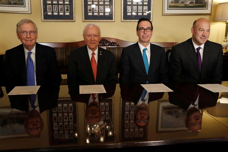 (L-R) Senate Majority Leader Mitch McConnell, Sen. Orrin Hatch, Treasury Secretary Steve Mnuchin and Director of the National Economic Council Gary Cohn introduce the Republican tax reform plan at the U.S. Capitol in Washington,