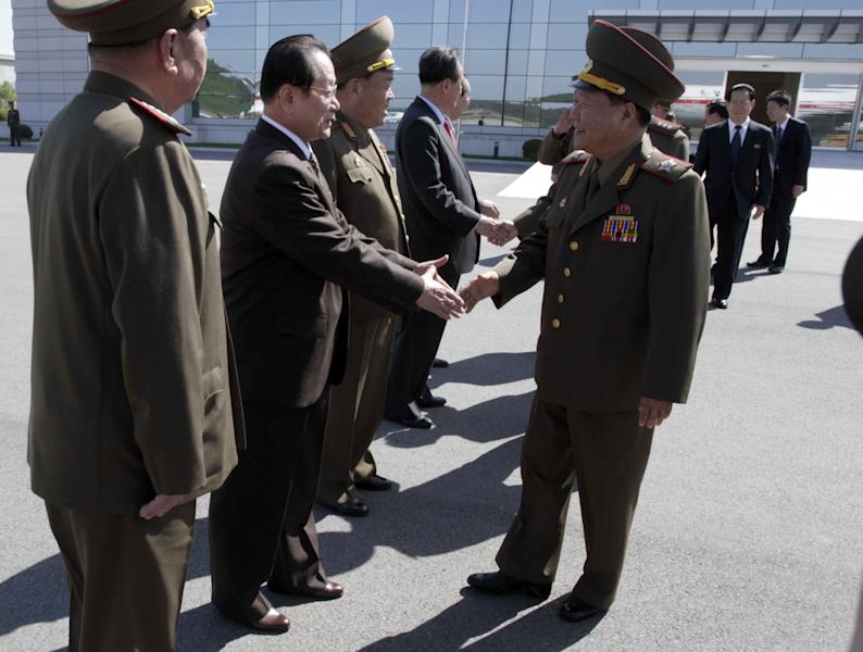 High-ranking North Korean party and military official Choe Ryong Hae, front right, shakes hands with officials as he departs for China as a special envoy of North Korean leader Kim Jong Un, at Pyongyang airport, North Korea Wednesday, May 22, 2013. The trip by Choe, a vice marshal who is director of the General Political Bureau of the Korean People's Army, is the highest-profile visit by a North Korean official to neighboring China this year and takes place at as Beijing is under pressure to rein in Pyongyang's provocations. (AP Photo/ Kim Kwang Hyon)