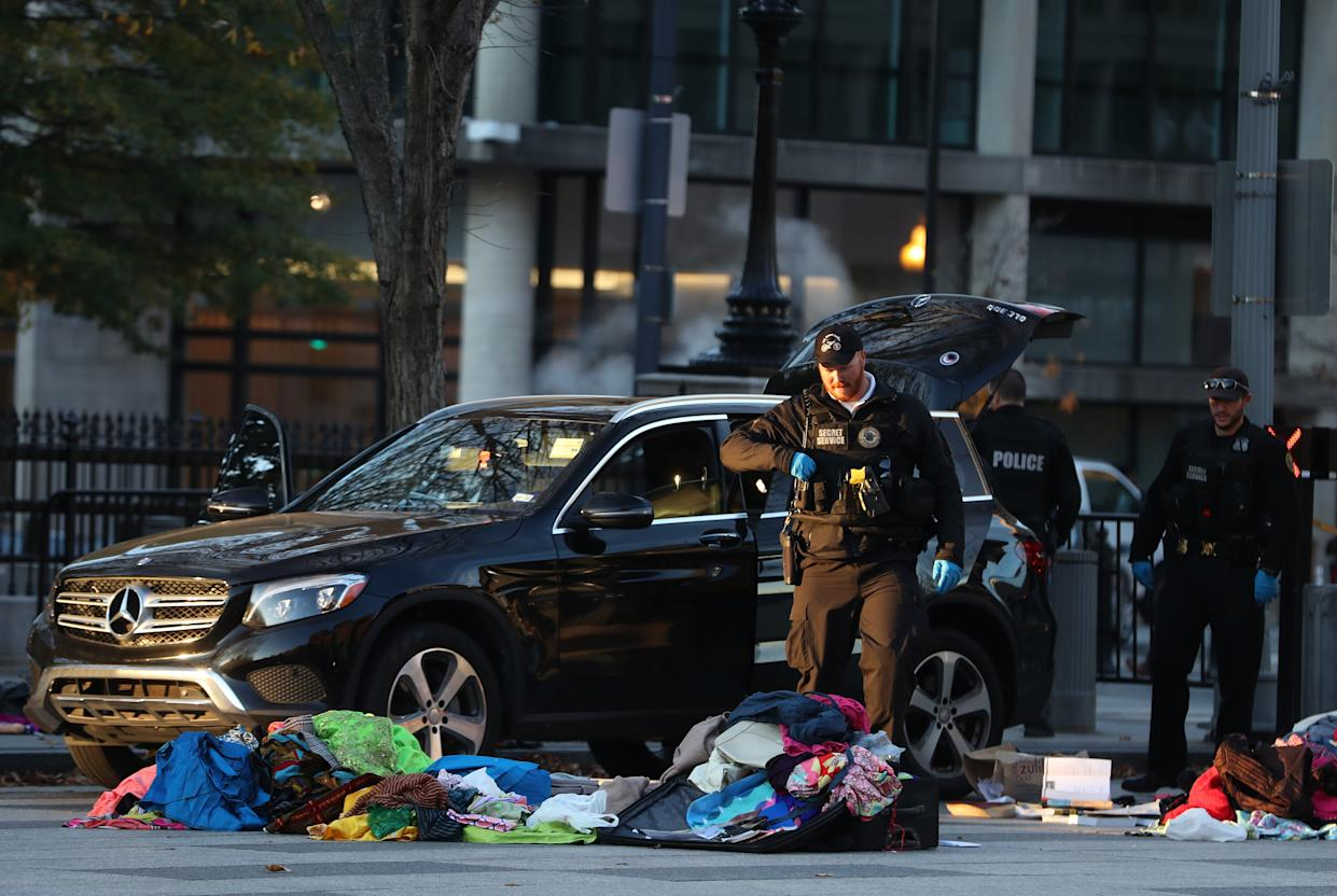Members of the U.S. Secret Service examine belongings removed from a vehicle that tried to drive into a restricted area near the White House, on Nov. 21, 2019.