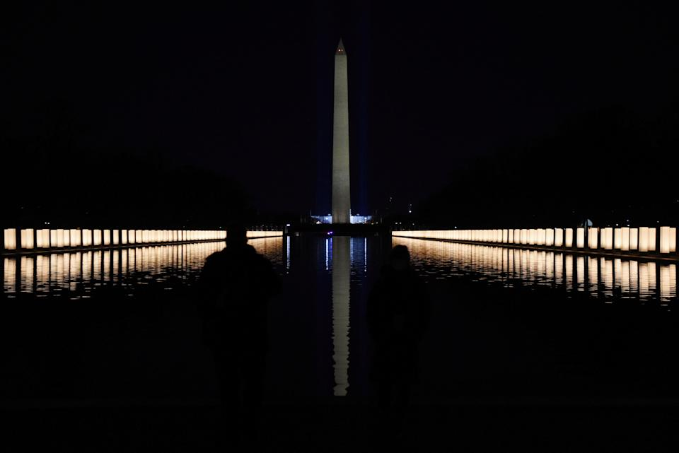 Lights illuminated the Reflecting Pool after President-elect Joe Biden hosted a memorial to honor those who have died in the U.S. from the coronavirus. (Photo: Callaghan O'Hare / Reuters)