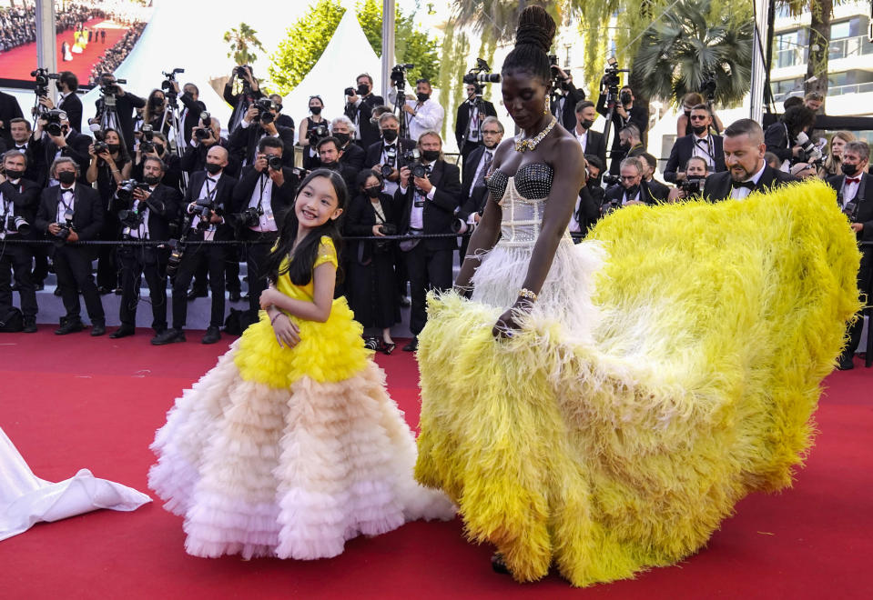 FILE - In this July 8, 2021 file photo Malea Emma Tjandrawidjaja, left, and Jodie Turner-Smith pose for photographers upon arrival at the premiere of the film 'Stillwater' at the 74th international film festival, Cannes, southern France. (AP Photo/Brynn Anderson, File)