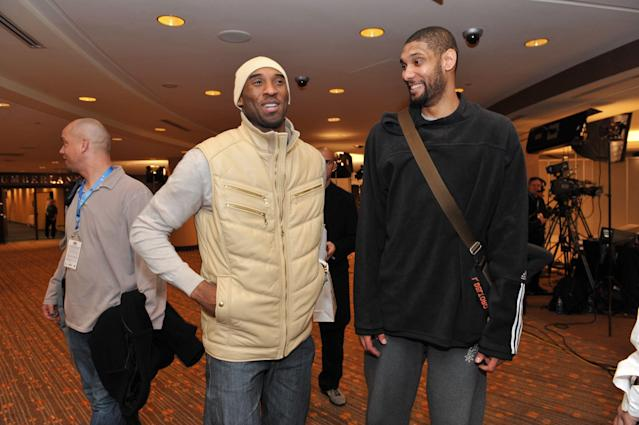 Kobe Bryant and Tim Duncan share a laugh at 2010 All-Star Weekend. (Photo by Jesse D. Garrabrant/NBAE via Getty Images)