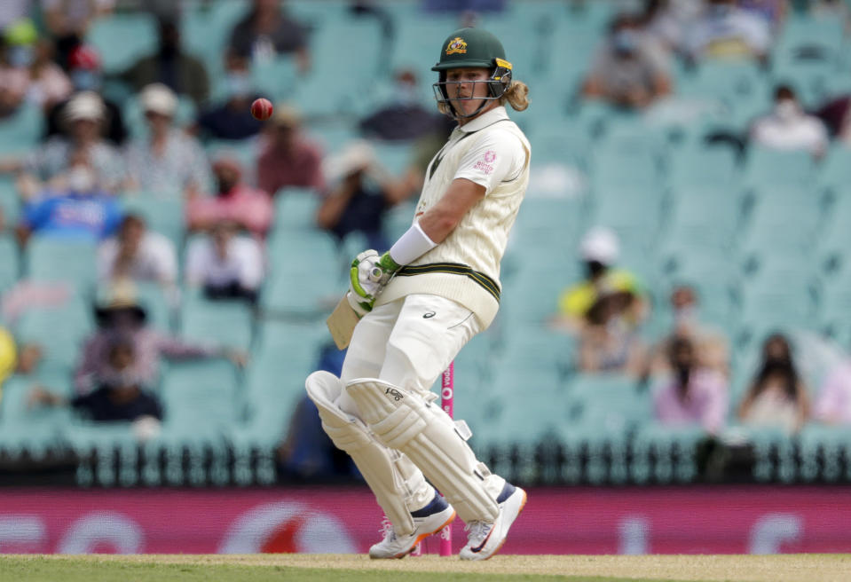 Australia's Will Pucovski lets a ball pass during play on day one of the third cricket test between India and Australia at the Sydney Cricket Ground, Sydney, Australia, Thursday, Jan. 7, 2021. (AP Photo/Rick Rycroft)